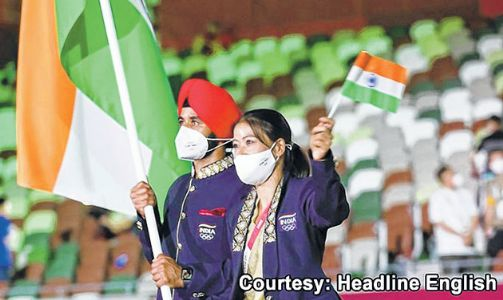 Mary Kom, Manpreet Singh lead India march